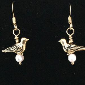 Gold tone bird earrings